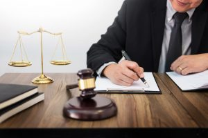 Lawyer specializing in real estate law writing legal contract